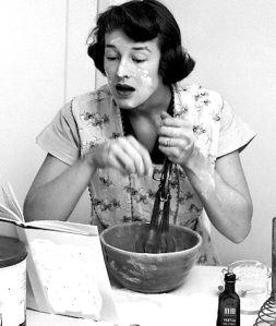 Woman face covered flour mixing ingredients reading brides cook book